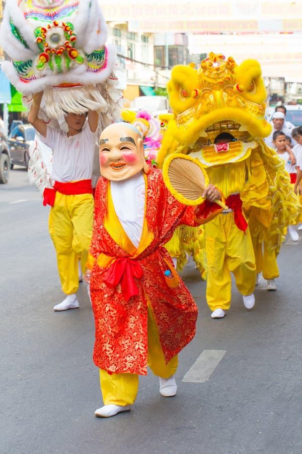 Lyckligt kinesiskt jokerfolk för nytt år med kines Dragon Dance Asian Arts Festival arkivfoto