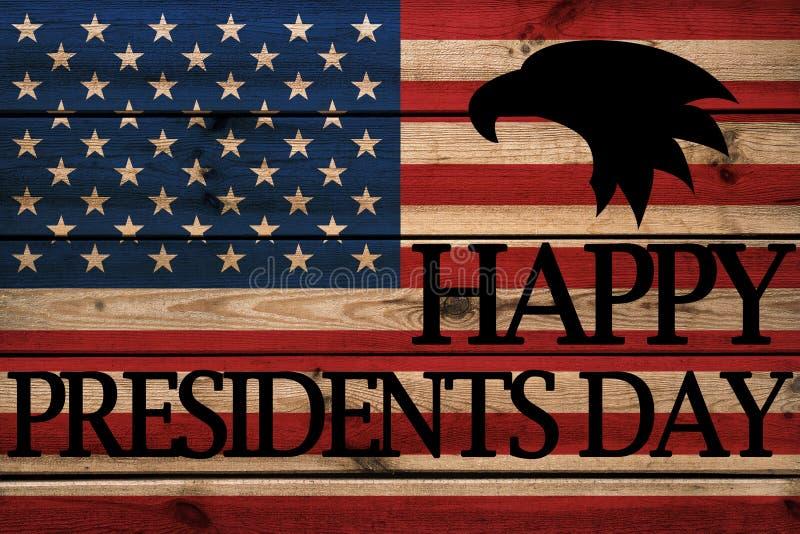 Lyckligt kort för presidentdaghälsning på träbakgrund royaltyfri fotografi