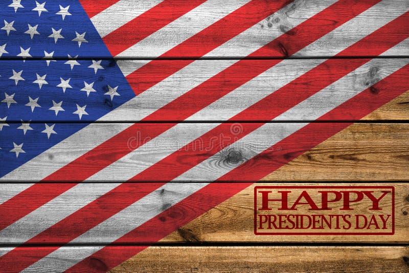 Lyckligt kort för presidentdaghälsning på träbakgrund royaltyfri bild