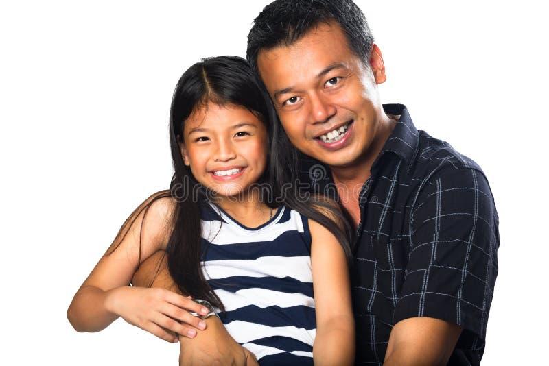 Lyckligt le för fader och för dotter royaltyfria foton