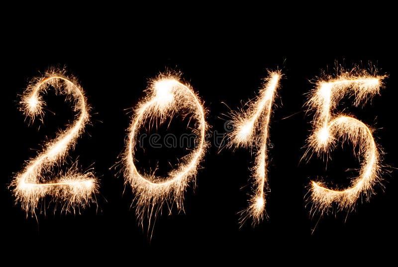 Lyckligt nytt år 2015 - inskriften gjorde tomtebloss royaltyfria bilder