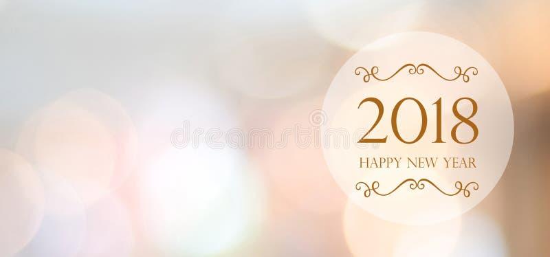 Lyckligt nytt år 2018 på bakgrund för suddighetsabstrakt begreppbokeh med kopian arkivbild