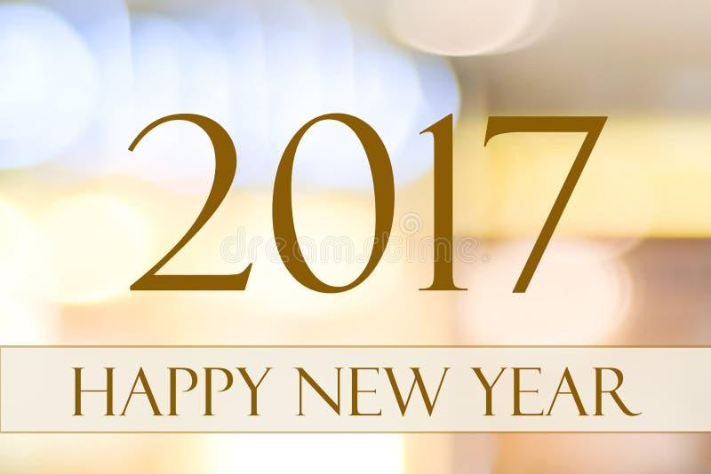 Lyckligt nytt år 2017 på festlig bokehbakgrund för abstrakt suddighet royaltyfri fotografi