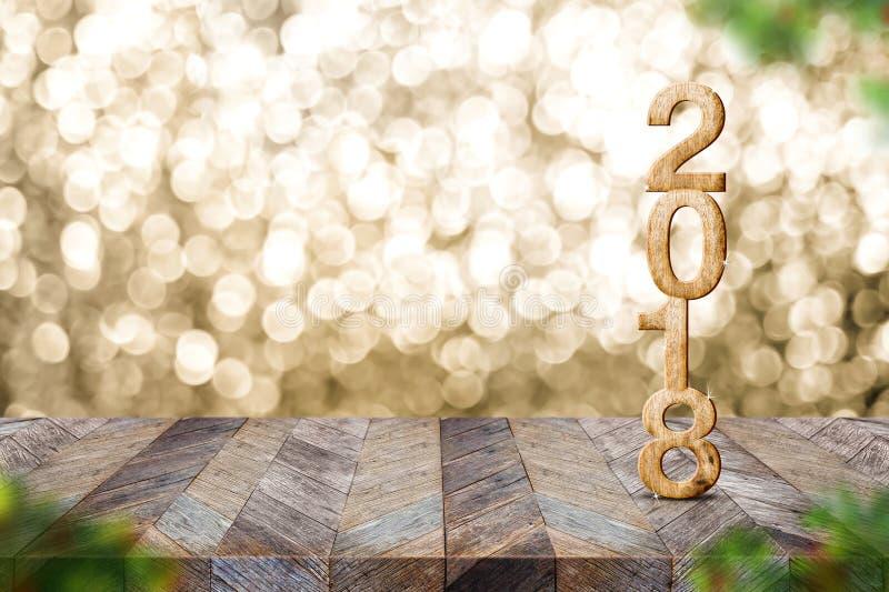 Lyckligt nytt år 2018 på wood tabell- och suddighetsjulgranforegr arkivfoto