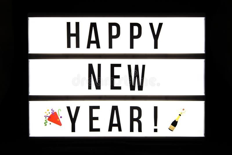 Lyckligt nytt år! text i en ljus ask royaltyfria bilder