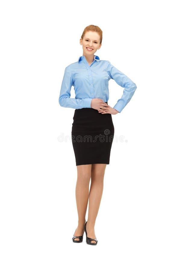 Lyckligt och le stewardessen royaltyfri bild