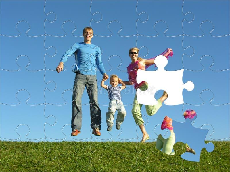 lyckligt pussel för familj royaltyfria bilder