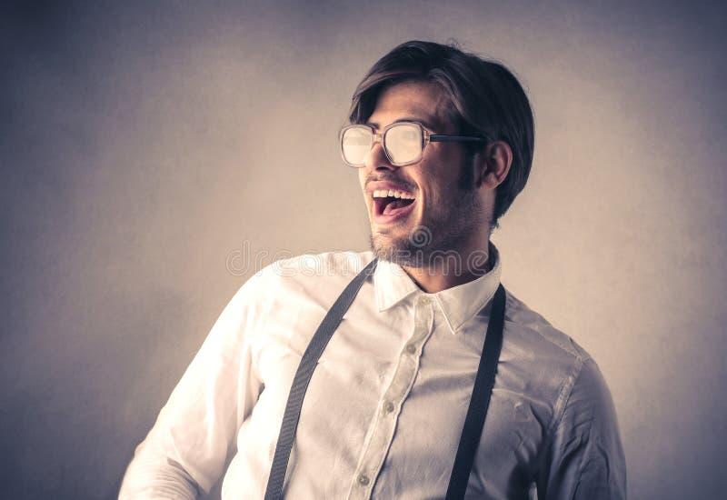 Lyckligt skratta för affärsman arkivbild