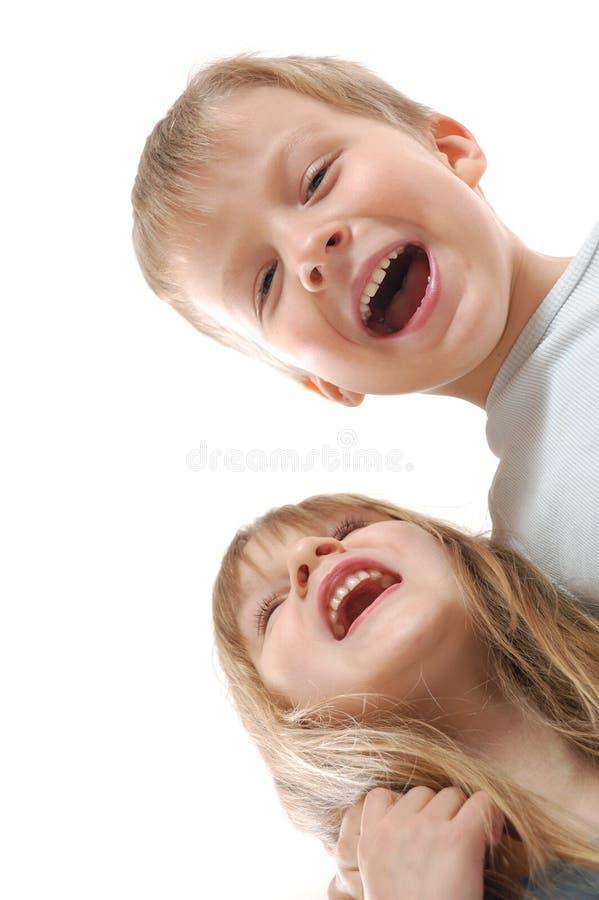 lyckligt skratta för barnvänner royaltyfria bilder