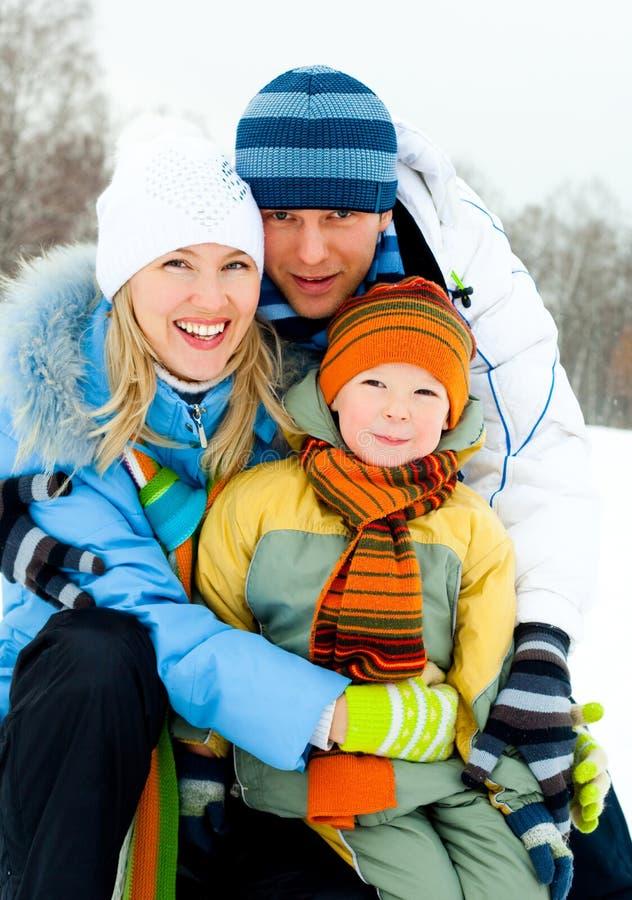 lyckligt utomhus- för familj royaltyfri bild