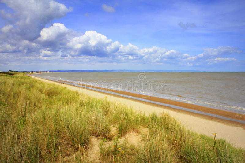 Lydd-on-Sea beach England United Kingdom. Scenic view of Lydd-on-Sea sandy beach and Dungeness Nature Reserve looking north to Folkestone and Dover cliffs.Lydd royalty free stock images