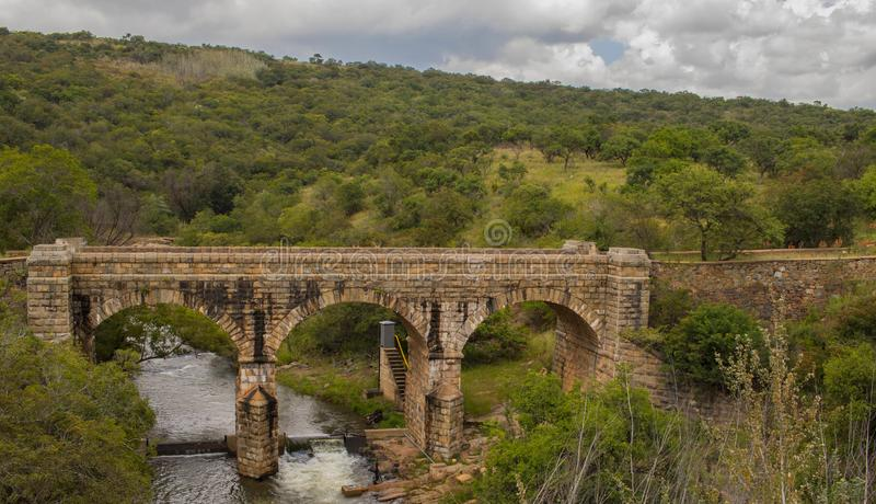Steenkamp Bridge outside the town of Lydenburg in South Africa. Lydenburg, South Africa - the historic Steenkamp Bridge outside town over the Spekboom River royalty free stock photography