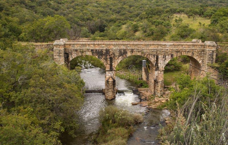Steenkamp Bridge outside the town of Lydenburg in South Africa. Lydenburg, South Africa - the historic Steenkamp Bridge outside town over the Spekboom River stock image