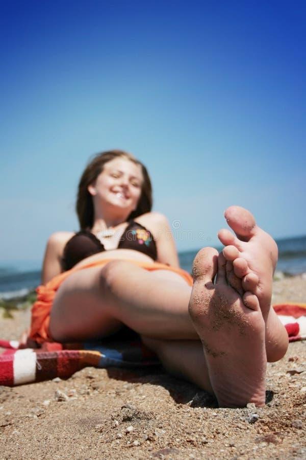 Lying on the beach royalty free stock photo