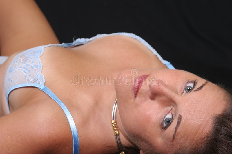 Lying In Blue Stock Images