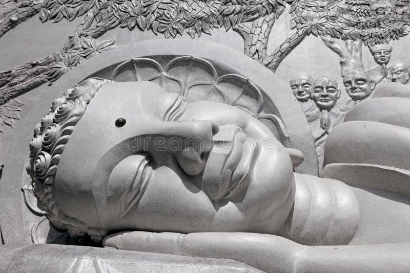 Lying Buddha statue. Fragment.