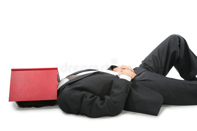 Download Lying Businessman With Book On Face Stock Image - Image: 8074747