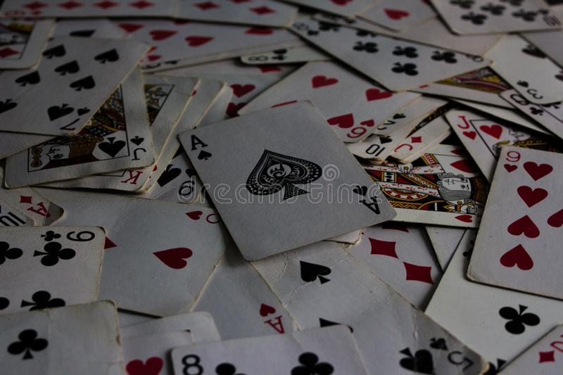 Lying cards with the selected card on top as a joker lady royalty free stock photo
