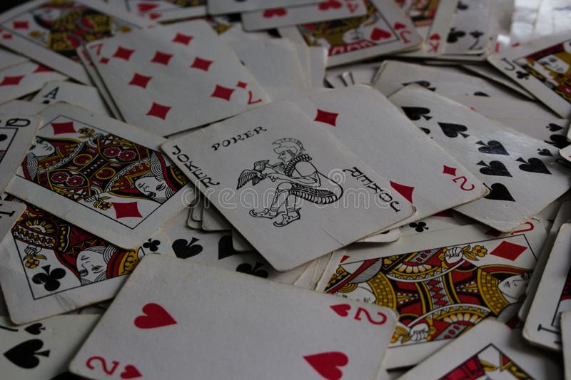 Lying cards with the selected card on top as a joker lady stock images