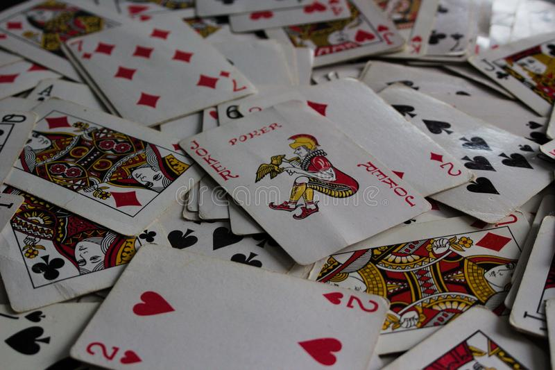 Lying cards with the selected card on top as a joker lady royalty free stock photography