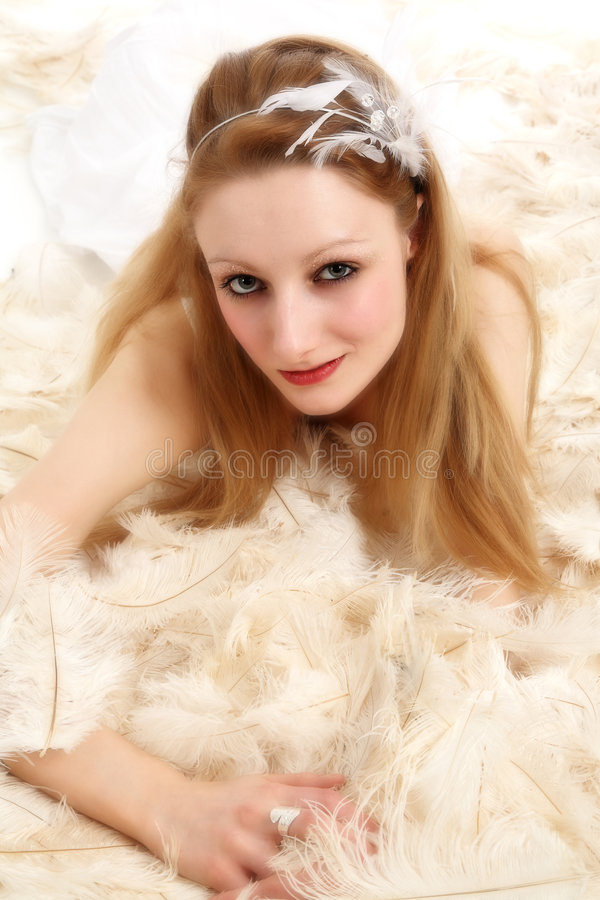 Lying on feathers royalty free stock images