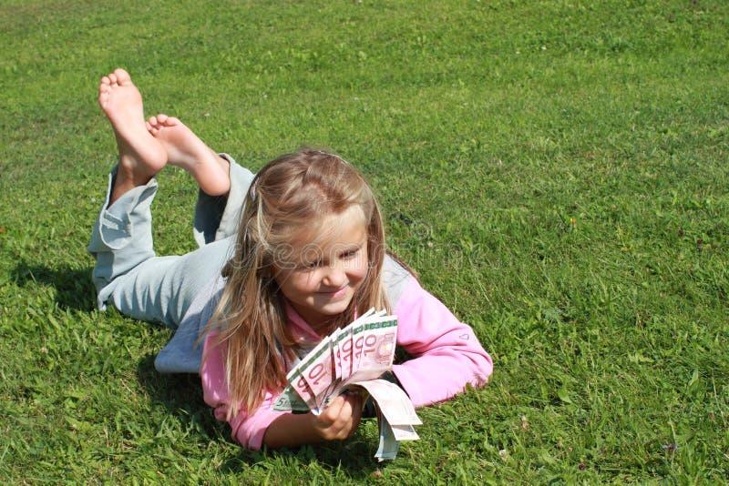 Lying girl watching money stock photos