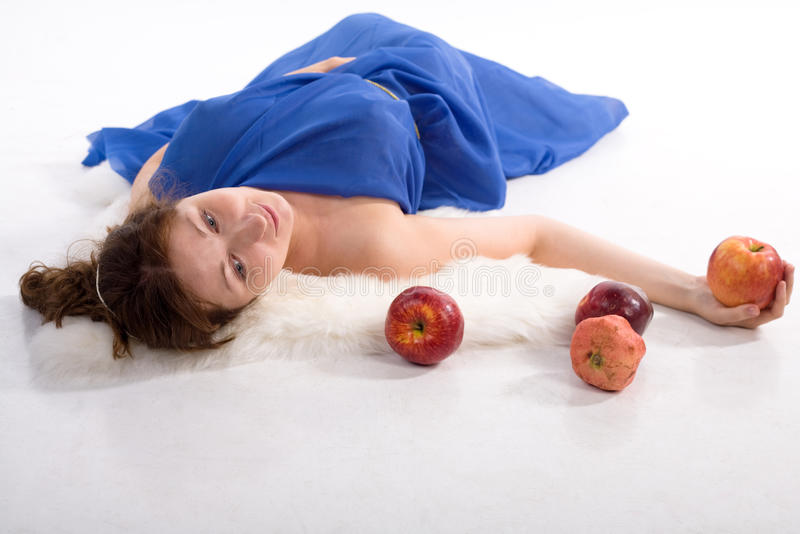 Lying lady with apples royalty free stock image