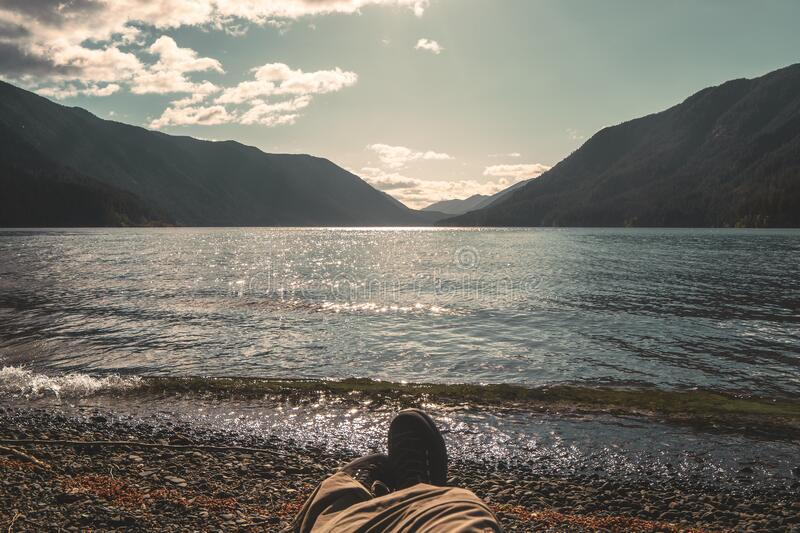 Lying on Lake Crescent shore on late afternoon, Olympic National Park, Washington state, USA. Vintage look royalty free stock photos