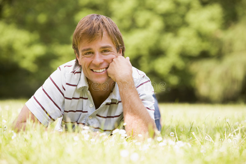 lying man outdoors smiling στοκ φωτογραφίες