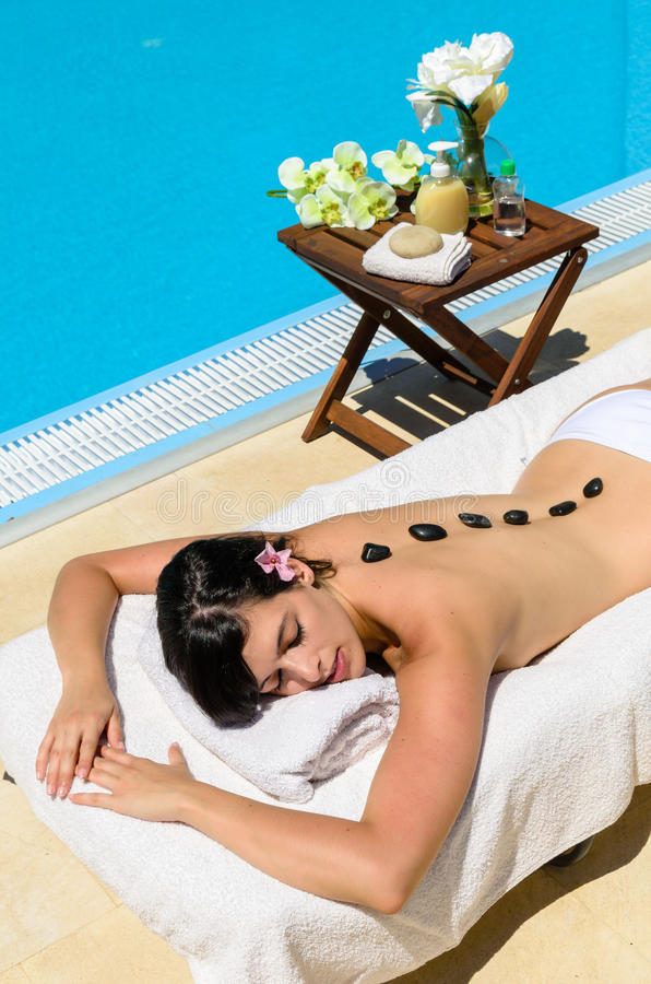 Lying in spa at poolside royalty free stock photo