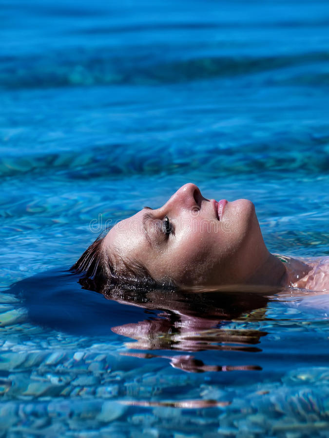 Lying woman at sea stock images