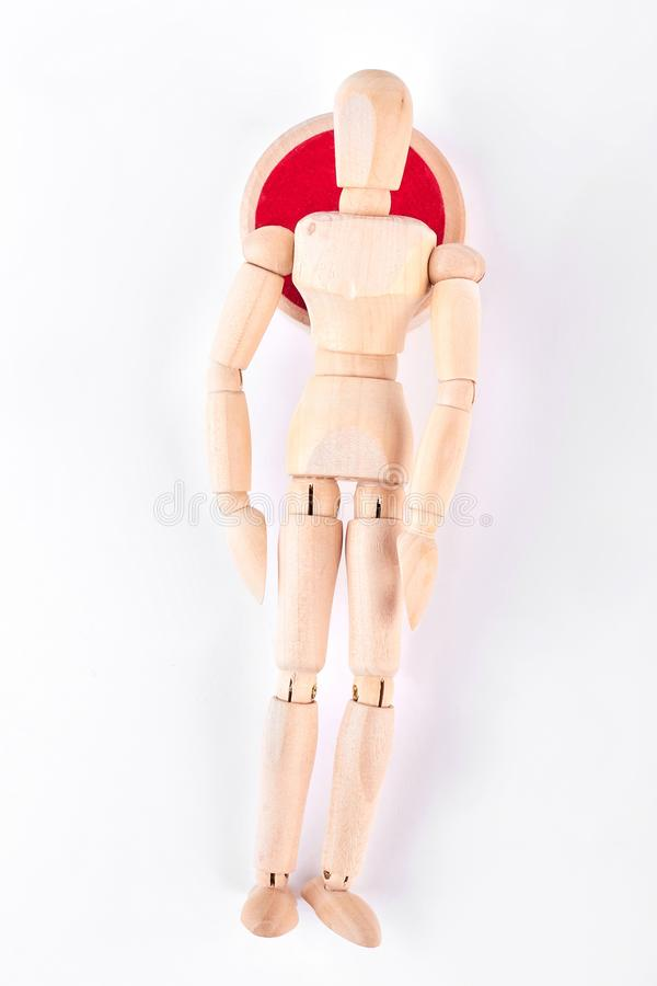 Lying wooden dummy, top view. stock photos
