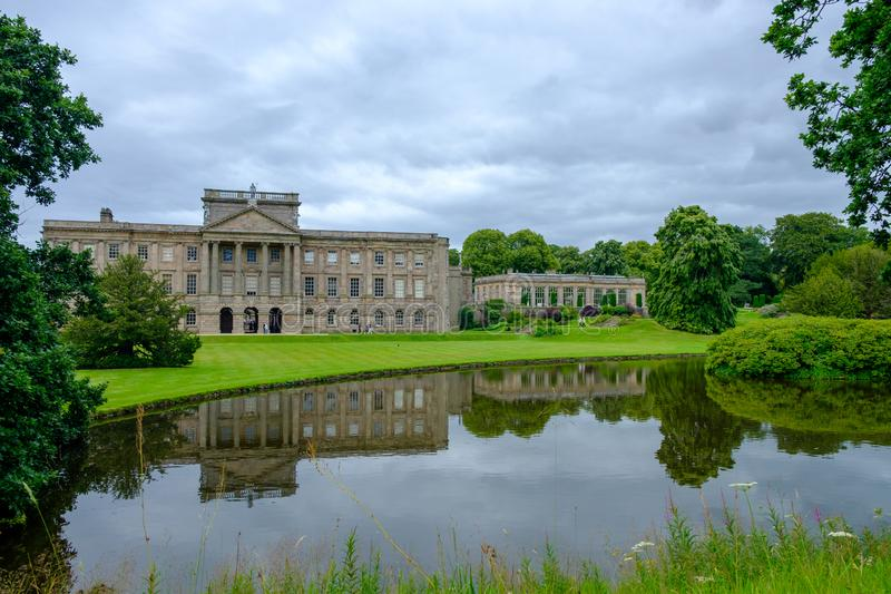Lyme Hall historic English Stately Home and park in Cheshire, UK. Stockport, United Kingdom - July 21, 2019: Lyme Hall historic English Stately Home and park in royalty free stock photo