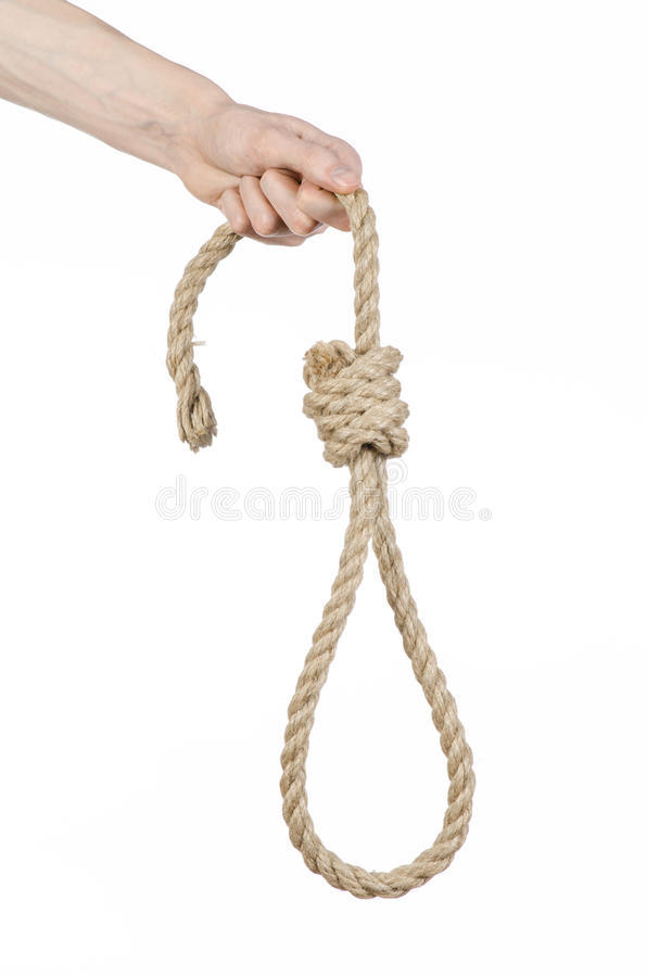 Lynching and suicide theme: man's hand holding a loop of rope for hanging on white isolated background. Studio royalty free stock images