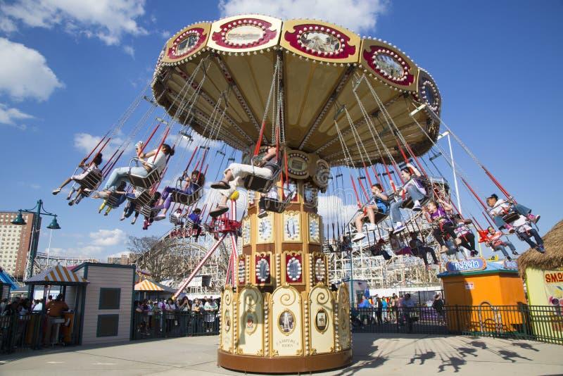 Lynn's Trapeze swing carousel in Coney Island Luna Park. BROOKLYN, NEW YORK - MAY 17: Lynn's Trapeze swing carousel on May 17, 2014 in Coney Island Luna Park stock image