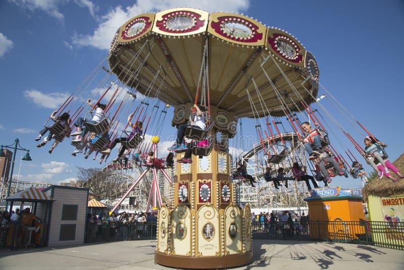 Lynn s Trapeze swing carousel in Coney Island Luna Park. BROOKLYN, NEW YORK - MAY 17 Lynn s Trapeze swing carousel on May 17, 2014 in Coney Island Luna Park stock photos