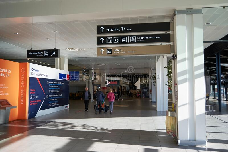 Inside one of Lyon Saint Exupery Airport terminals with direction signs royalty free stock photos