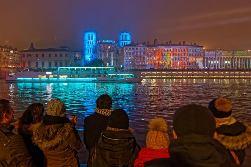 Crowd at the Festival of Lights on Saone River banks. LYON, FRANCE, December 5, 2019 : Festival of Lights on Cathedral and Saone River banks. For 4 nights stock image