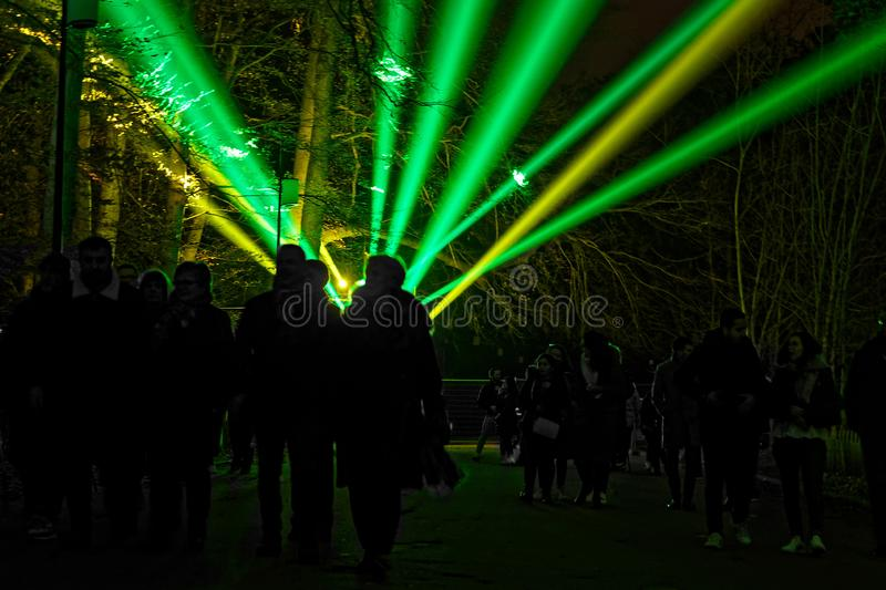 Crowd druing Festival of Lights in Parc de la Tete d`Or. LYON, FRANCE, December 7, 2019 : The Festival of Lights lights up the Parc de la Tete d`Or. For 4 nights royalty free stock photography