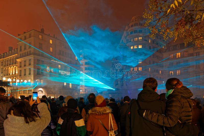 Crowd for the Laser show on the fountain for Festival of Lights. LYON, FRANCE, December 5, 2019 : Laser show on the fountain for Festival of Lights. For 4 nights stock photo