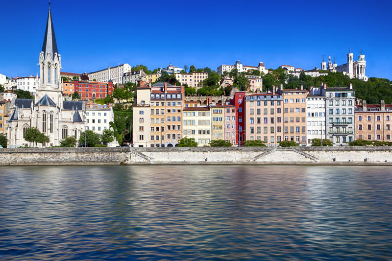 Lyon France. Houses on banks of Saone River, Lyon, France. Fourviere Basilica on hill royalty free stock photography