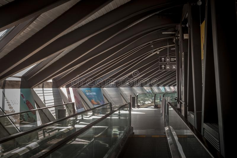 Travelator and Moving Walkway in Lyon Airport, also called Aeroport de Lyon Saint Exupery, empty, connecting two terminals. LYON, FRANCE - JULY 13, 2019 royalty free stock images