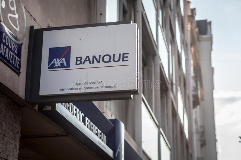 Axa Banque logo on their local agent in Lyon. Axa is a French insurance and banking group, one of the biggest insurers of Europe. LYON, FRANCE - JULY 14, 2019 royalty free stock image