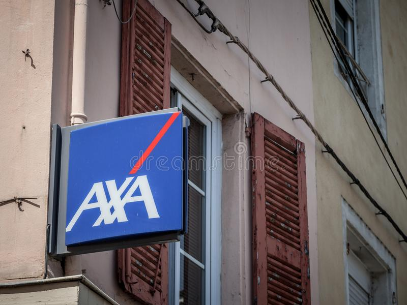 Axa logo on their local agent in Lyon. Axa is a French insurance and banking group, one of the biggest insurers of Europe. LYON, FRANCE - JULY 17, 2019 royalty free stock photo