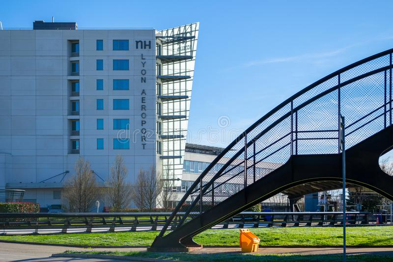 Hotel NH Lyon Airport as seen from the one of the airport`s terminals, with a staircase on the right. Lyon, France - 16 March 2019: Hotel NH Lyon Airport as seen stock photos