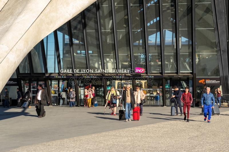 People arriving and departing at Gare de Lyon Saint Exupery SNCF main station, with carry on bags stock images
