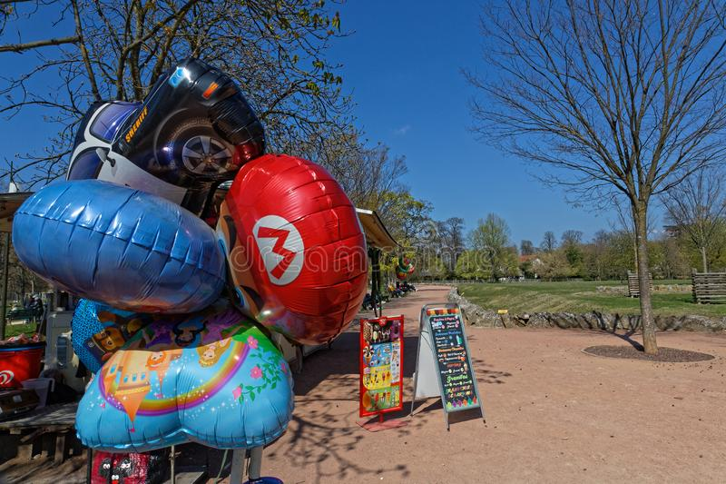 Ballons on a sunny spring afternoon in Parc de la Tete d`Or stock image