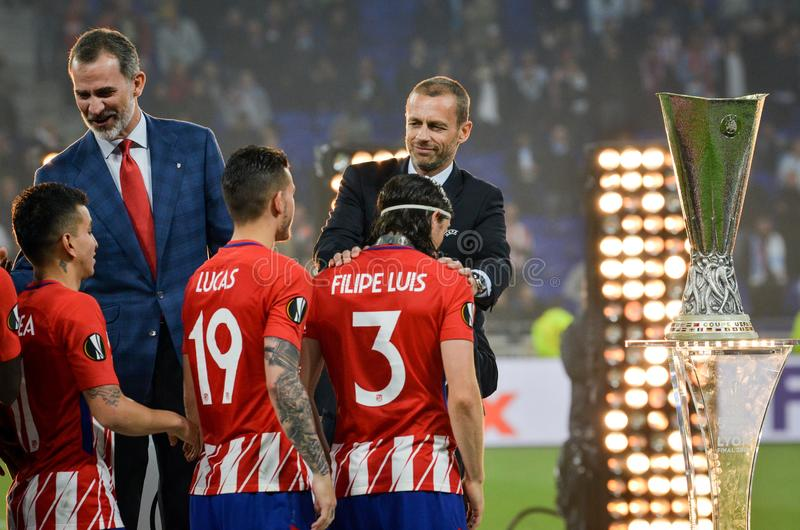 LYON, FRANCE - 16 May, 2018: Footballers Atletico Madrid and Filipe Luis receive the UEFA Europa League gold medals royalty free stock images
