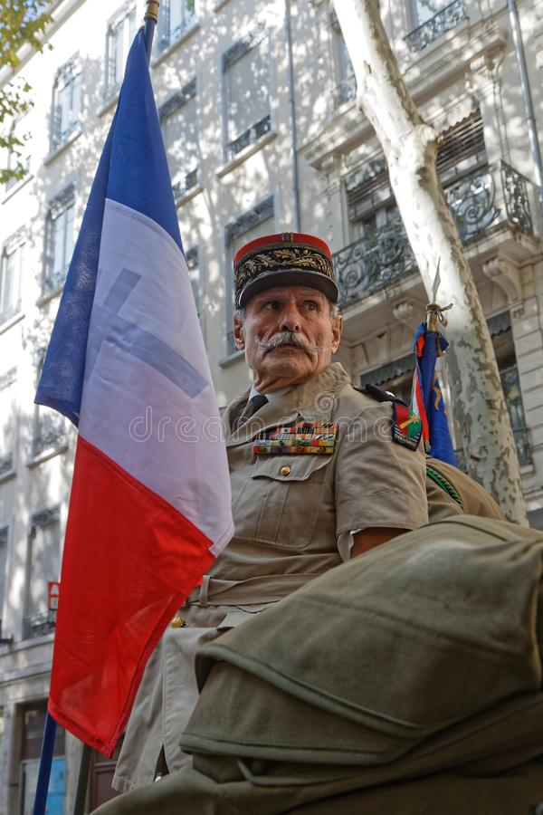 A General and french flag in Lyon royalty free stock photos