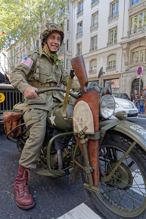Military man on a motorbike in Lyon stock photography